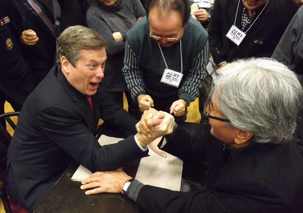 John Tory arm wrestle