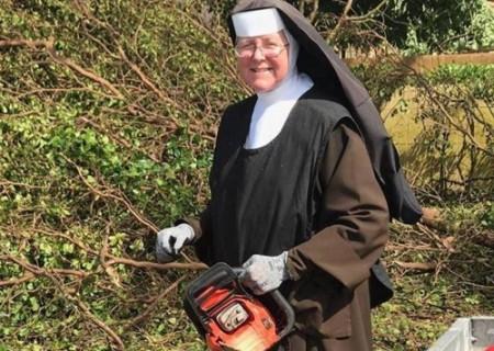 nun with power saw